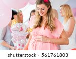 pregnant girl celebrating baby... | Shutterstock . vector #561761803