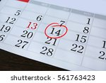 calendar page with a red hand... | Shutterstock . vector #561763423