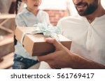 cute little girl is giving her... | Shutterstock . vector #561769417