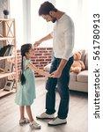 cute little girl and her... | Shutterstock . vector #561780913