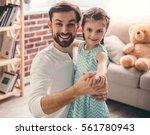 cute little girl and her... | Shutterstock . vector #561780943