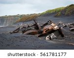 Small photo of Wreck of the SS Waitangi lies half submerged on Patea breakwater beach in New Zealand.