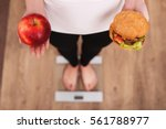 diet. woman measuring body... | Shutterstock . vector #561788977