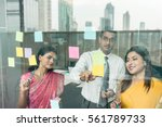 three indian employees sticking ... | Shutterstock . vector #561789733