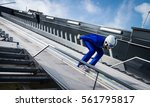 ski jumper in squatting position | Shutterstock . vector #561795817