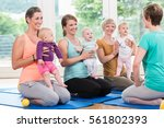 women and their babies in... | Shutterstock . vector #561802393