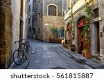 narrow street in florence ... | Shutterstock . vector #561815887