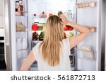 rear view of young woman... | Shutterstock . vector #561872713