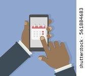 callendar in smartphone. man...   Shutterstock .eps vector #561884683