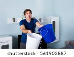 young male worried man holding... | Shutterstock . vector #561902887
