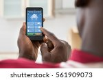 close up of african man using... | Shutterstock . vector #561909073