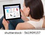 close up of woman doing online... | Shutterstock . vector #561909157