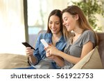 two roommates using their smart ... | Shutterstock . vector #561922753