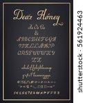 golden latin letters on black... | Shutterstock .eps vector #561924463