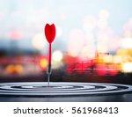 close up shot red dart arrow on ... | Shutterstock . vector #561968413