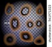 set of burnt holes on... | Shutterstock .eps vector #561971323