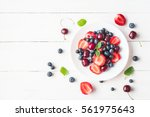 fruit salad with strawberry ... | Shutterstock . vector #561975643