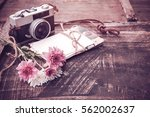 Vintage Camera With Bouquet Of...
