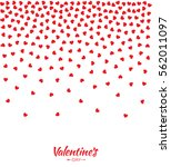 abstract red small hearts... | Shutterstock .eps vector #562011097