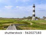 a board walk leads the eye to... | Shutterstock . vector #562027183