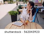 young beautiful business woman... | Shutterstock . vector #562043923