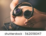 pregnant woman holding...   Shutterstock . vector #562058347