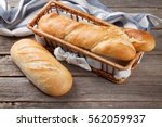 fresh bread on wooden table  | Shutterstock . vector #562059937