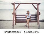 beautiful young woman sat on a... | Shutterstock . vector #562063543