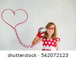 happy girl with red vintage... | Shutterstock . vector #562072123