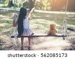 Cute Little Girl Sitting Swing...