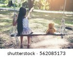 cute little child sitting... | Shutterstock . vector #562085173