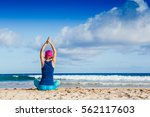 young woman practicing yoga on... | Shutterstock . vector #562117603