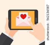 online love envelope. tablet  ...   Shutterstock .eps vector #562136587