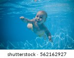 Baby Learns To Swim. Child...