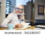 happy business woman talking on ... | Shutterstock . vector #562180357