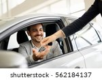 salesperson selling cars at car ... | Shutterstock . vector #562184137