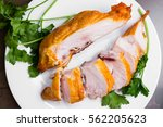 smoked chicken breast on a... | Shutterstock . vector #562205623