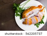 smoked chicken breast on a... | Shutterstock . vector #562205737