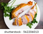 smoked chicken breast on a... | Shutterstock . vector #562206013
