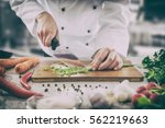 chef cooking food kitchen... | Shutterstock . vector #562219663