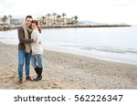 young beautiful couple hugging... | Shutterstock . vector #562226347