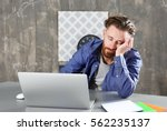 young tired man sleeping at... | Shutterstock . vector #562235137