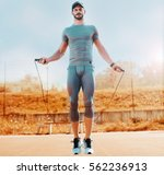 rope jumping. young sportsman... | Shutterstock . vector #562236913
