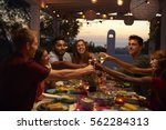 friends make a toast at a... | Shutterstock . vector #562284313