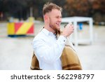 a young man drinking coffee... | Shutterstock . vector #562298797