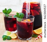 Small photo of Homemade Delicious Red Sangria with Limes, Oranges, Lemons and Mint