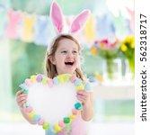 happy little girl in bunny ears ... | Shutterstock . vector #562318717