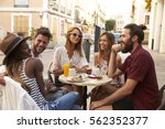 friends on vacation laughing... | Shutterstock . vector #562352377