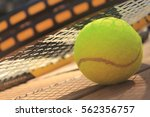 tennis balls and racquet | Shutterstock . vector #562356757