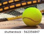 tennis balls and racquet | Shutterstock . vector #562356847